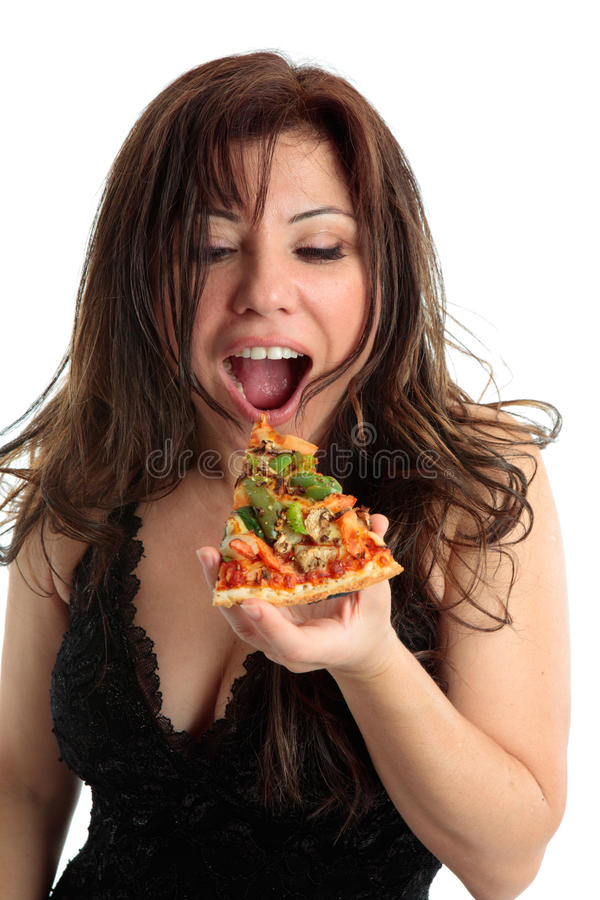Eating Pizza. A woman eating a slice of delicious pizza stock photos
