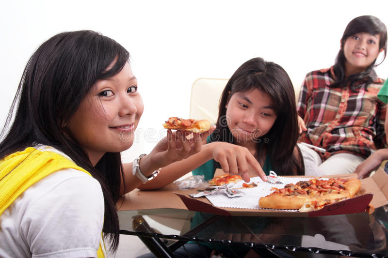Eating pizza together stock images