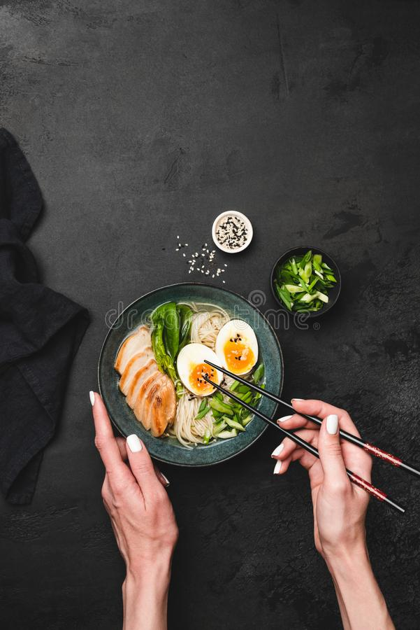 Eating ramen soup with chicken and egg stock photography