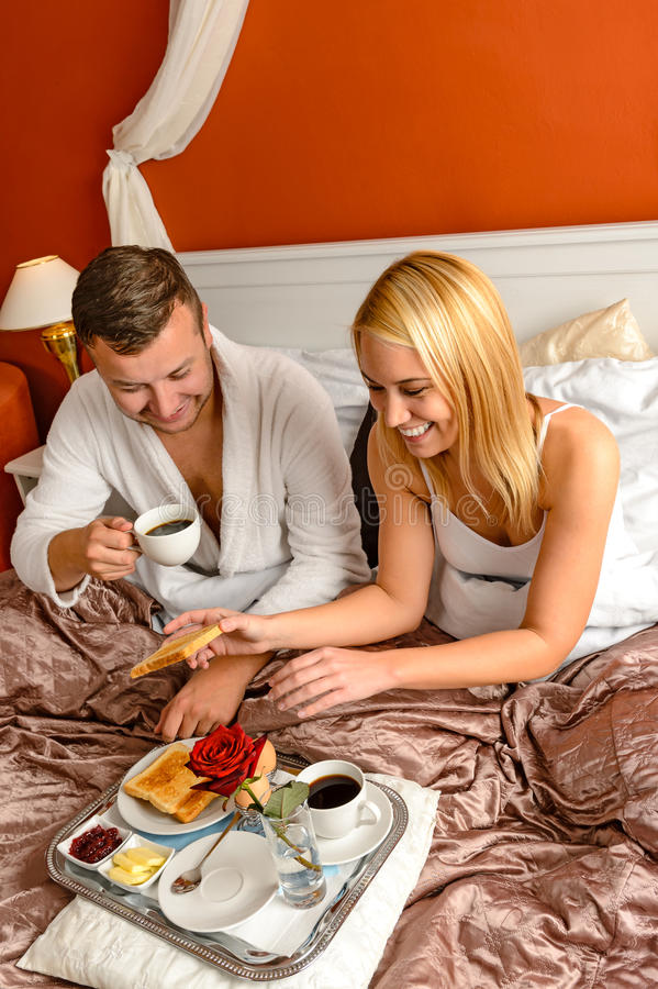 Eating romantic breakfast bed smiling couple Valentine's. Eating romantic breakfast in bed smiling couple Valentine's day stock images