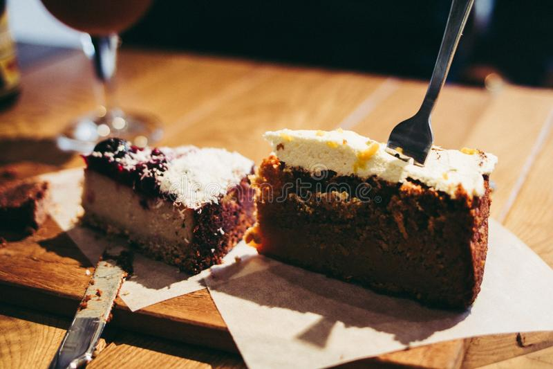Eating slice of carrot and cheese cake on robust wooden table wi royalty free stock photos