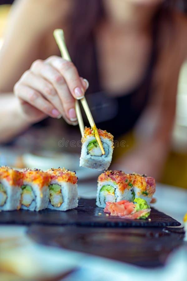 Eating sushi royalty free stock image