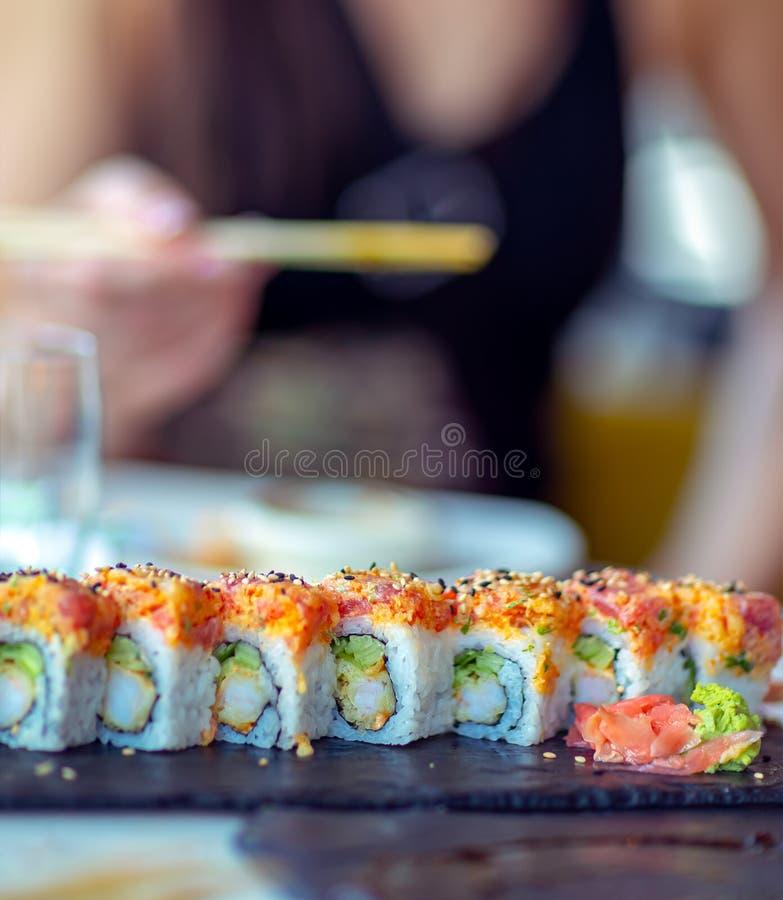Eating sushi royalty free stock photography
