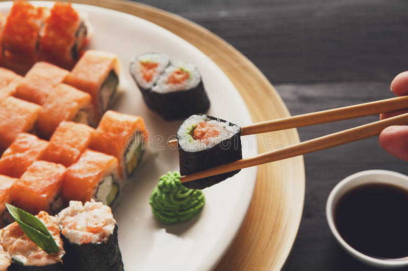 Eating sushi rolls at japanese food restaurant royalty free stock photography