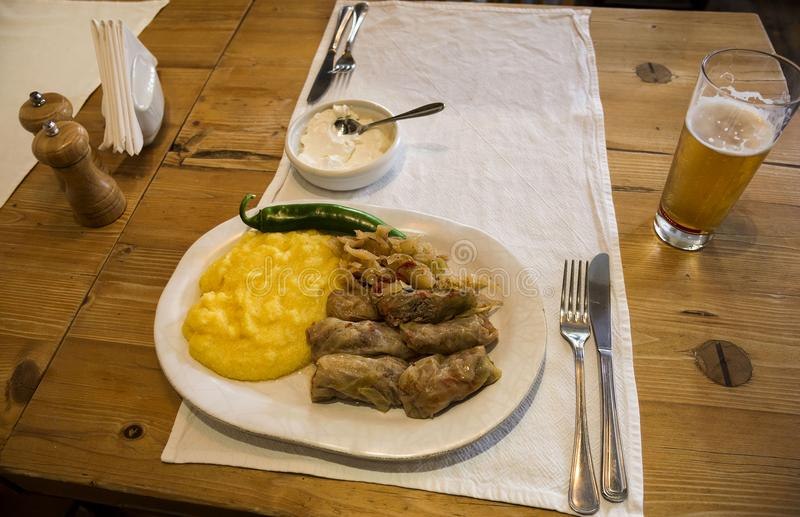 Eating traditional sarmale in `Tears and Saints ` Restaurant, Bucharest. BUCURESTI, ROMANIA - SEPTEMBER 13, 2017.Eating traditional sarmale in `Tears and Saints royalty free stock photo