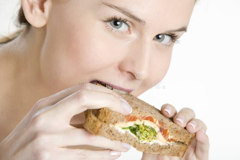 Eating woman royalty free stock image