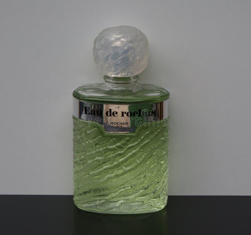 Eau de Rochas, fragranza per le signore, grande bottiglia di profumo fotografia stock libera da diritti
