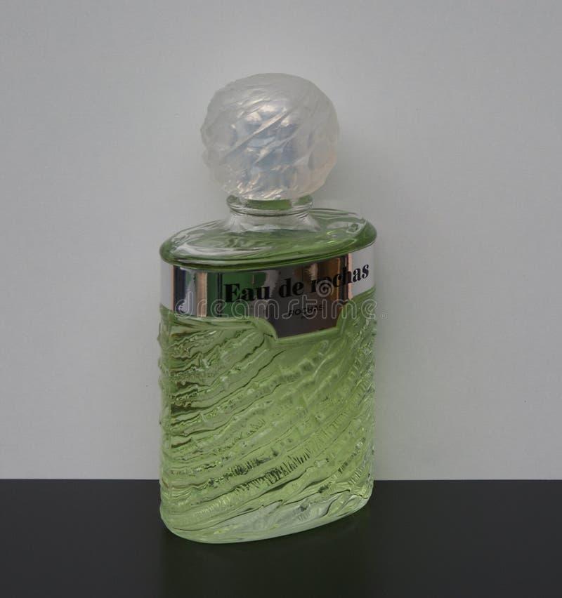 Eau de Rochas, fragranza per le signore, grande bottiglia di profumo fotografie stock libere da diritti