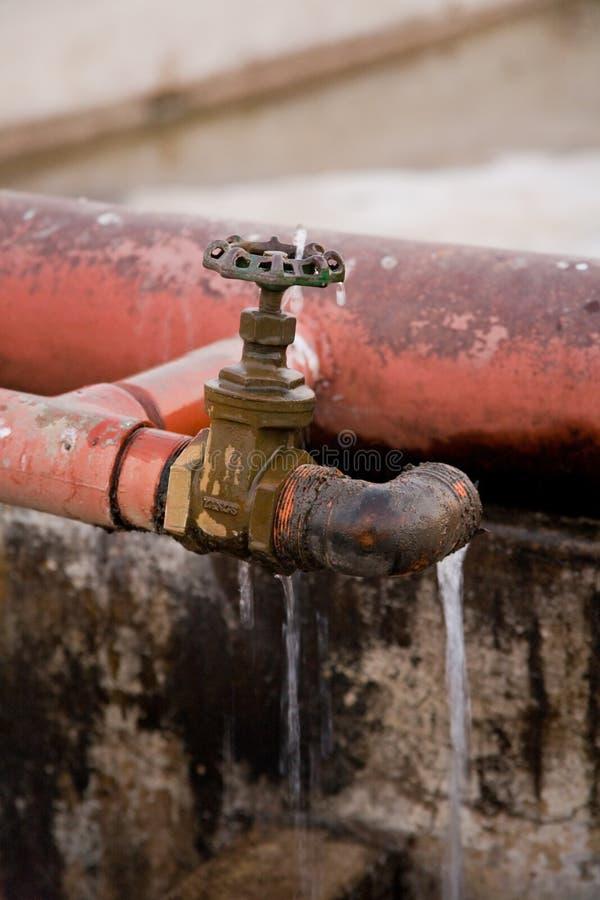 eau du robinet disjointe image libre de droits
