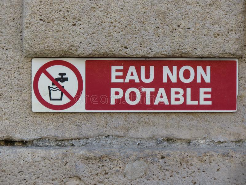 Eau non potable. Meaning Not drinkable water warning sign written in French language royalty free stock photos