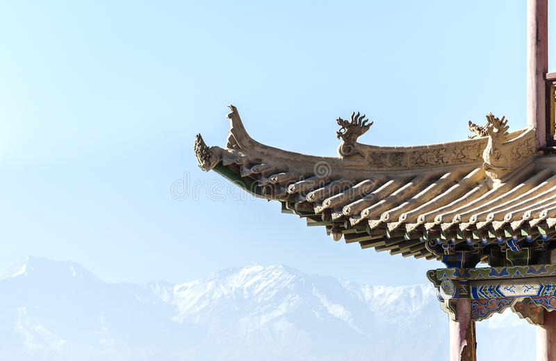 Download Eaves Of A Tower In Jiayuguan Against Distant Snow-capped Mounta Stock Image - Image of dynasty, outdoors: 28210635