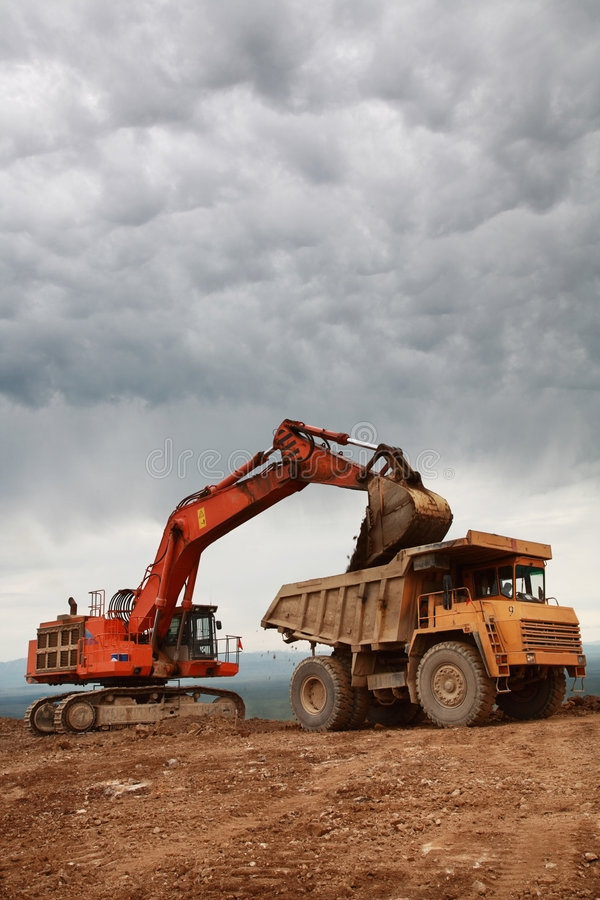 Eaxcavator loading truck royalty free stock image