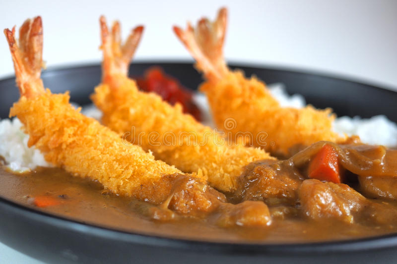 Ebi Fried Curry Rice , Deep Fried Prawn with Japanese Curry style on rice , selective focus point royalty free stock image