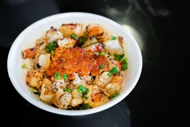 Ebidon donburi. Grilled prawn shrimp ebidon Donburi with salmon roe and egg stock photos