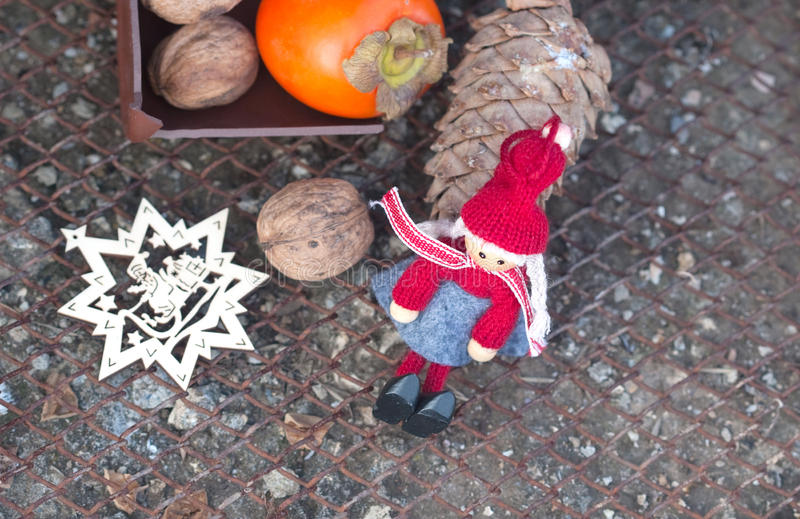 Ebony, walnuts, fir cone and New Year's toys stock photography