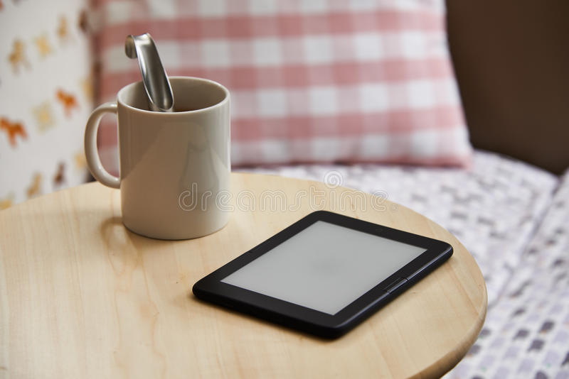Ebook device with blank screen, isolated on a table stock image
