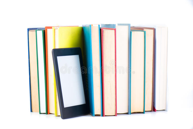 Ebook among paper books. new technology concept. With white background royalty free stock image