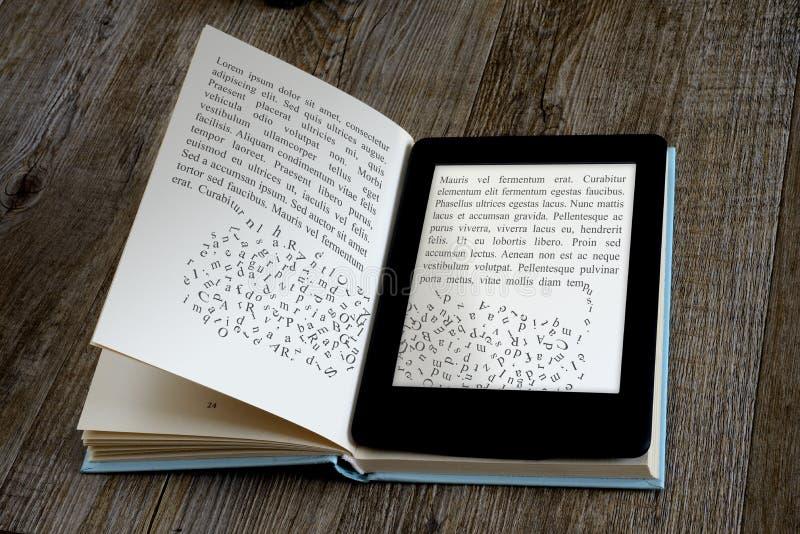 Ebook reader. Modern ebook reader on book on wooden background stock photos