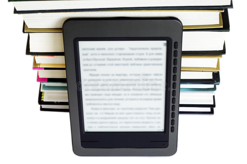 Download Ebook reader on pile books stock photo. Image of book - 18404426