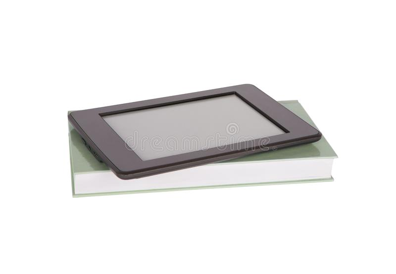 Ebook reader tablet with blank screen and a paper book. Isolated stock photography