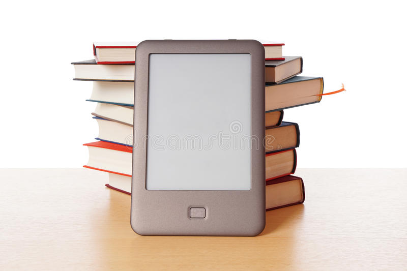 Ebook reader vs pile of books. Modern ebook reader stacked against pile of old books stock images
