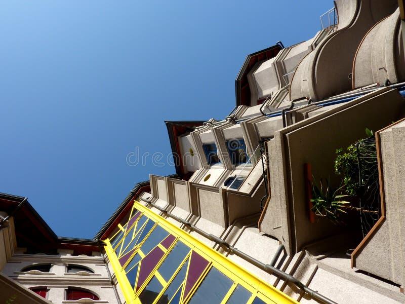 Eccentric facade of a modern building stock images