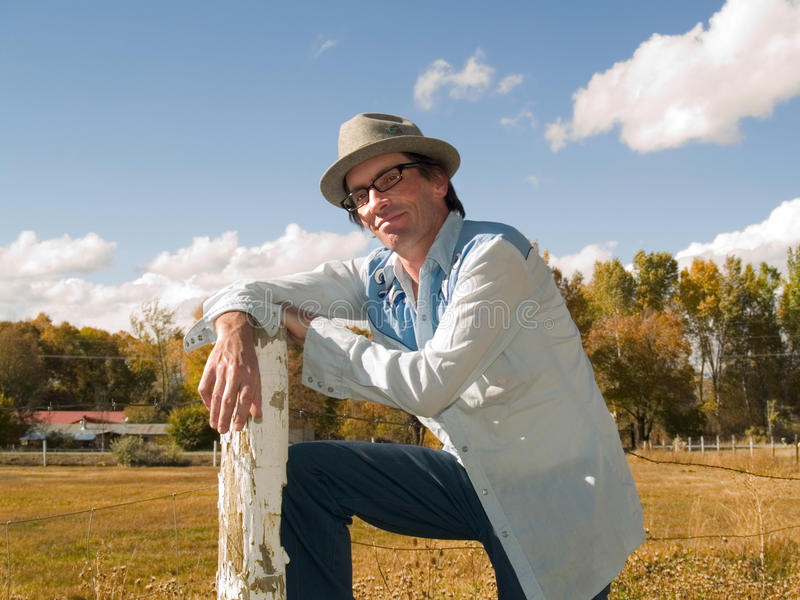 Download Eccentric Man Leaning To A Fence Post Stock Photo - Image: 11322056