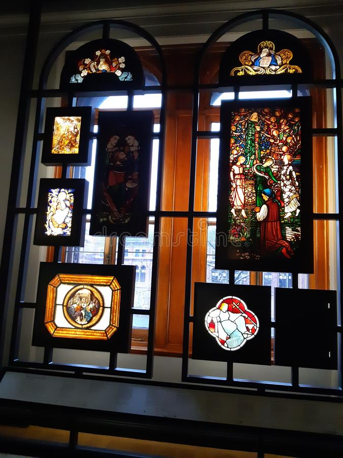 Ecclesiastical antique stained glass. Ecclesiastical exhibits glass and silverware royalty free stock photos
