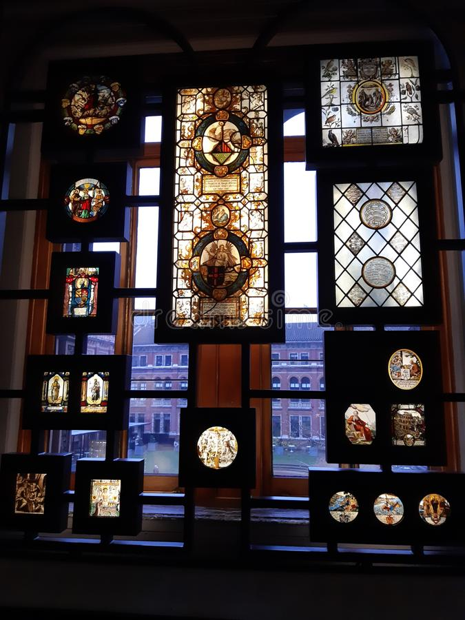 Ecclesiastical antique stained glass. Ecclesiastical exhibits glass and silverware stock photo