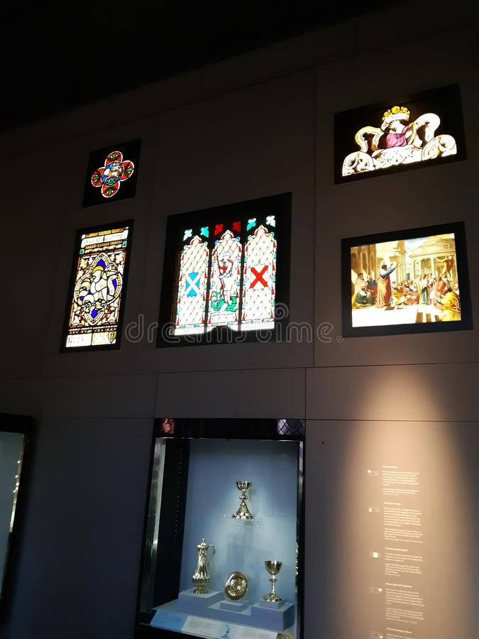 Ecclesiastical antique stained glass. Ecclesiastical exhibits glass and silverware stock image
