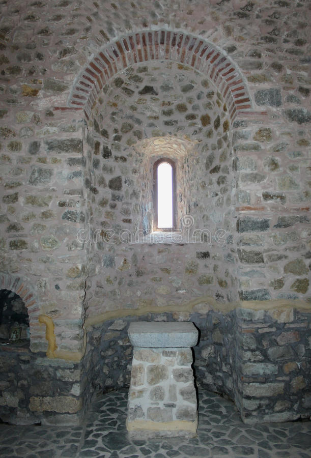 Ecclesiastical window. Above an ancient shrine, detail royalty free stock photo