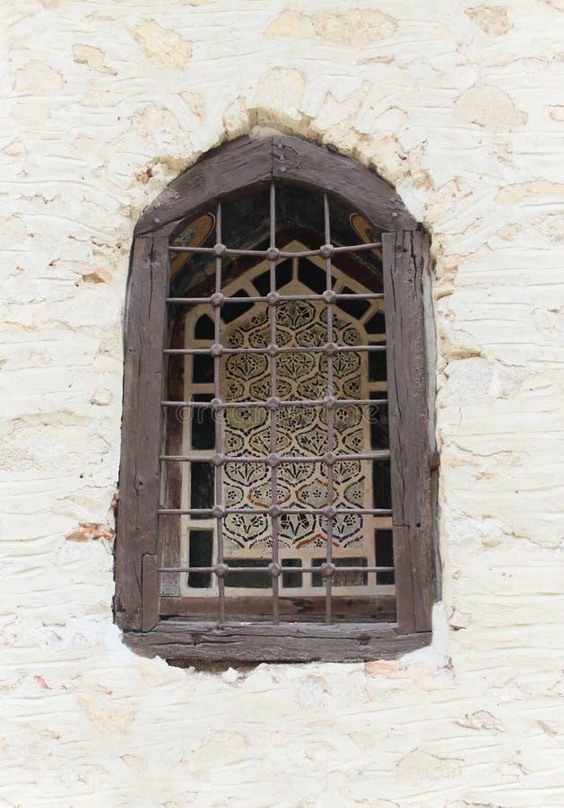 Ecclesiastical window. Old ecclesiastical window in Bulgarian town of Melnik stock image