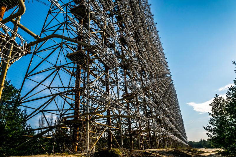Echo of the Cold War. Secret Soviet over the horizon antenna known as the `Russian woodpecker`. Chernobyl Nuclear Disaster Exclusi. Old grand Soviet construction royalty free stock image