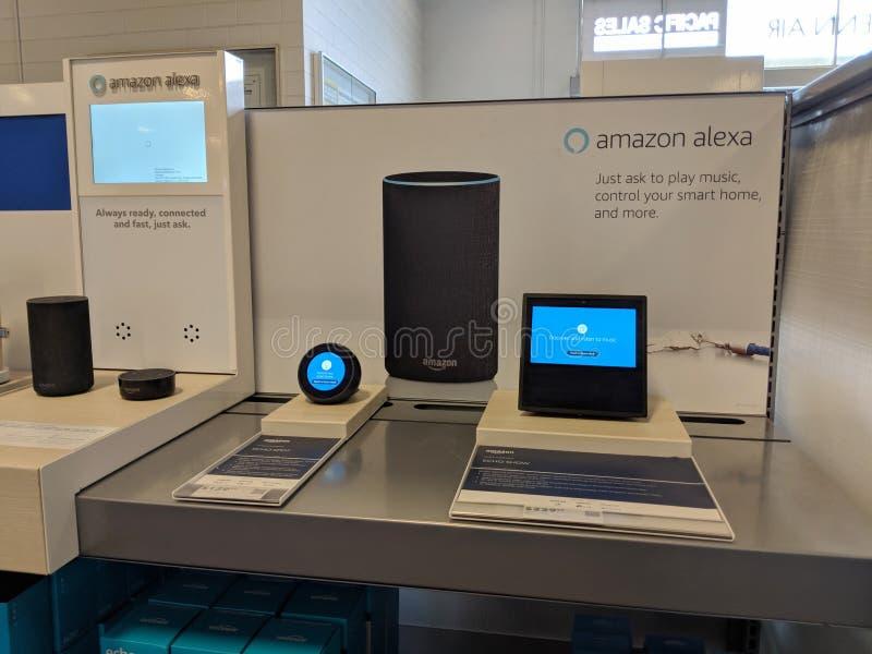 Echo Dot & 2nd Generation  - Smart speaker with Alexa - Black on display. Honolulu - August 10 2018: Echo Spot and Echo Show - Smart speaker with Alexa - Black stock photography