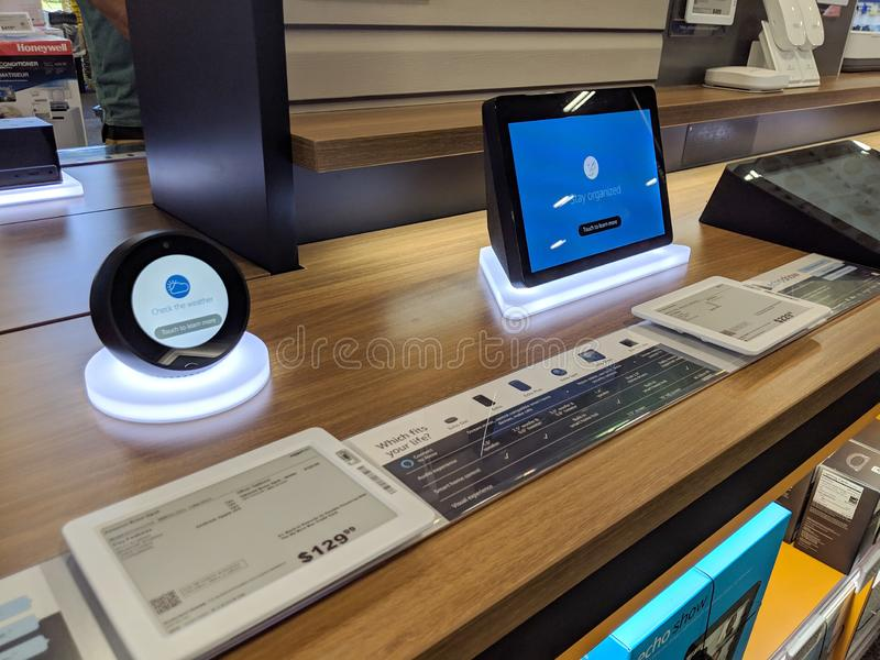 Echo Spot and Echo Show - Smart speaker with Alexa - Black on display. Honolulu -  March 16, 2019:  Echo Spot and Echo Show - Smart speaker with Alexa - Black on stock photos