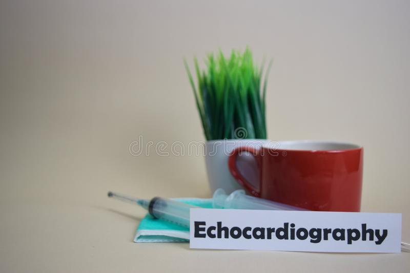 Echocardiography text, grass pot, coffee cup, syringe, and face green mask. stock photos
