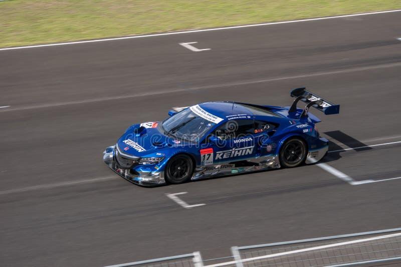 ECHT Hideki Mutoh van KEIHIN RENNEND in Super Definitieve Race 66 van GT Overlapping stock fotografie