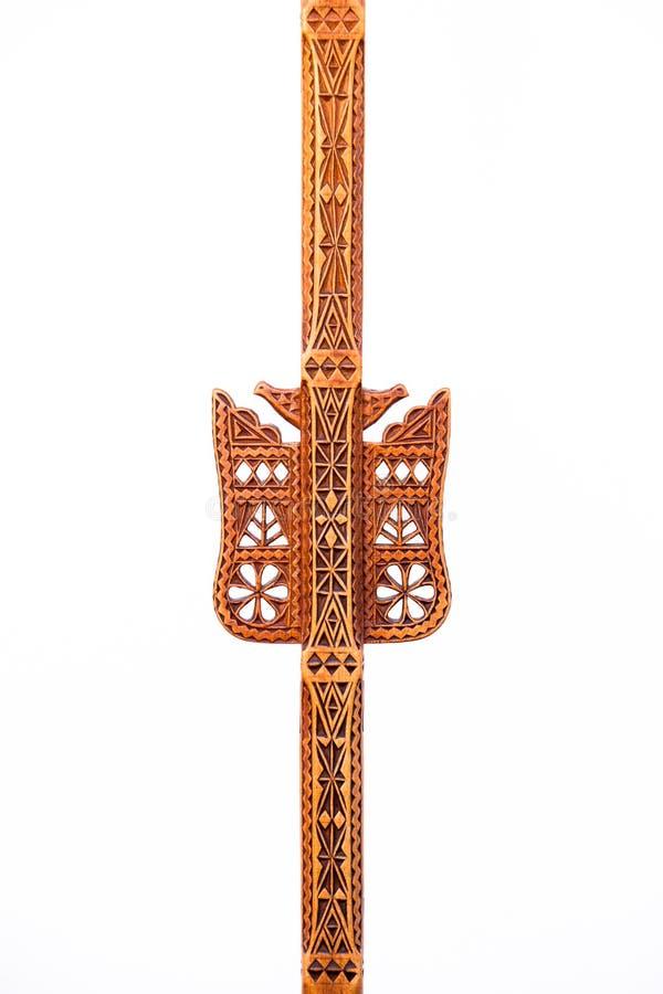 Echte Met de hand gemaakte Houten Geometrische Kunstdecoratie op een Geïsoleerd Spinrokhulpmiddel royalty-vrije stock afbeelding