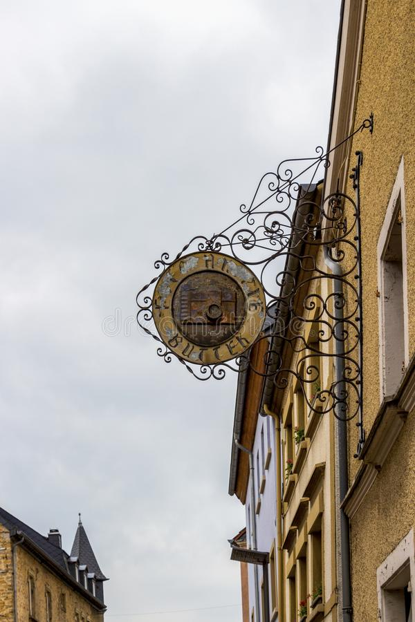 Echternach, Luxembourg old architecture. ECHTERNACH, LUXEMBOURG - MAY 25, 2016: Old weathered Photo Atelier Buttek street sign in Echternach, Grevenmacher royalty free stock photo