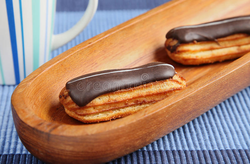 Download Eclairs On Blue Table Cloth Stock Image - Image: 19215553