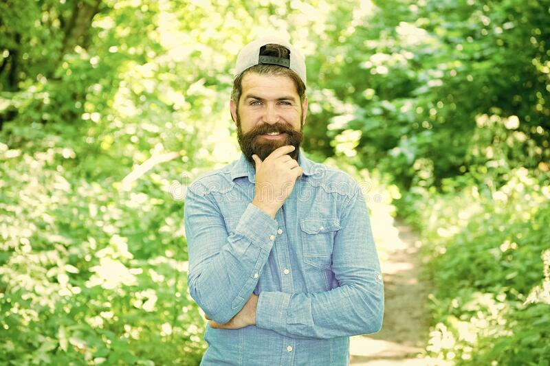 Eco activist. Man handsome bearded guy in sunny forest. United with environment. Go green think fresh. Earth day. Protect nature eco movement. Eco lifestyle royalty free stock photo