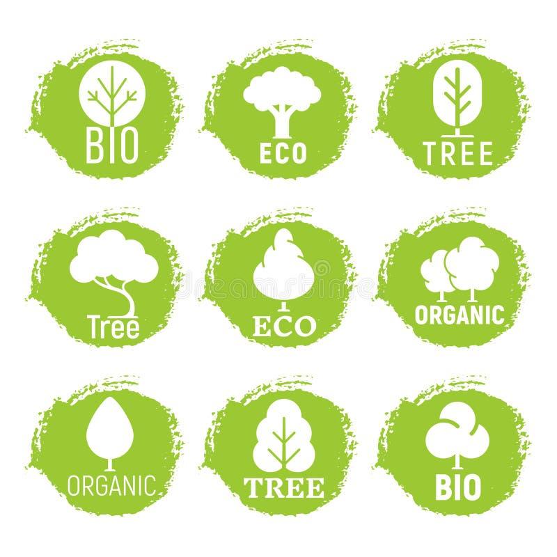 Eco amistoso, orgánico, logotipos del árbol en fondo verde del grunge libre illustration