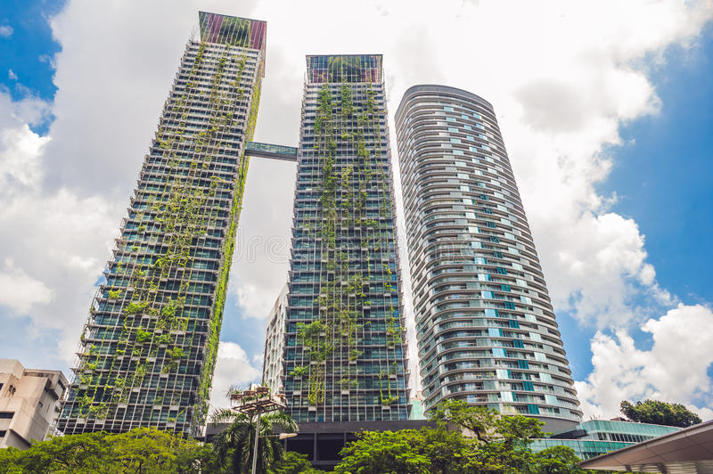 Eco architecture. Green skyscraper building with plants growing on the facade. Ecology and green living in city, urban environment stock image