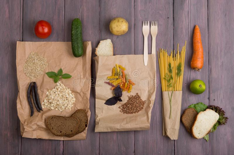 Eco bags with products rich of complex carbohedrates: cereals, bread, pasta and vegetables royalty free stock photo