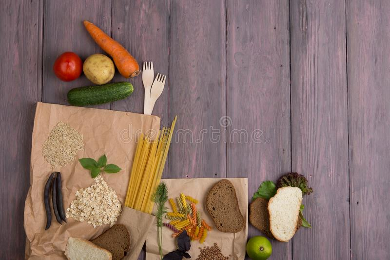 Eco bags with products rich of complex carbohedrates: cereals, bread, pasta and vegetables royalty free stock image