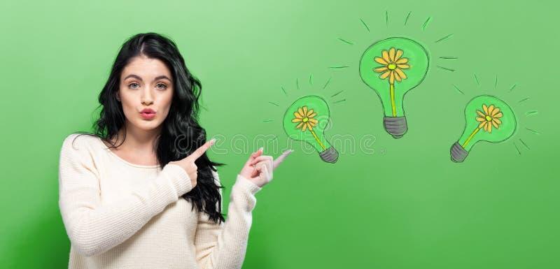 Eco energia z młodą kobietą obraz stock