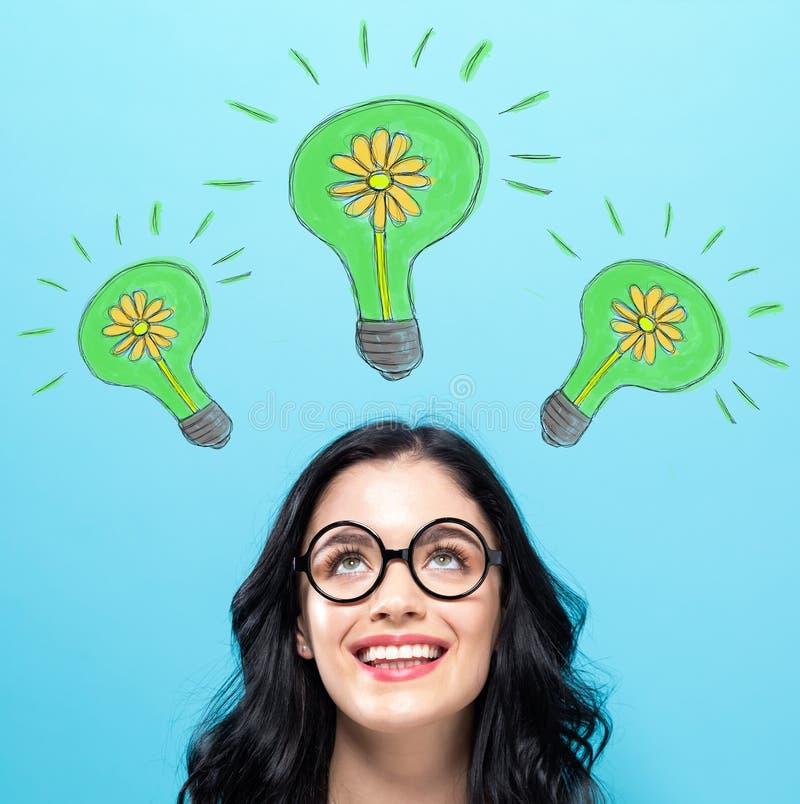Eco energia z szczęśliwą młodą kobietą obrazy royalty free