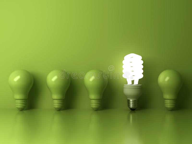 Eco energy saving light bulb , one glowing compact fluorescent lightbulb standing out from unlit incandescent bulbs reflection royalty free illustration