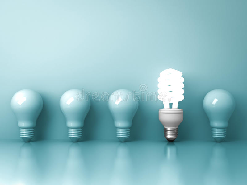 Eco energy saving light bulb , one glowing fluorescent lightbulb standing out from unlit incandescent bulbs reflection on green stock illustration
