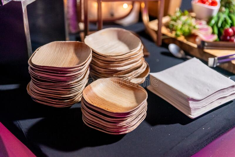 Eco environmentally friendly palm leaf plates from natural sustainable leaves. Eco environmentally friendly palm leaf plates made from natural sustainable leaves royalty free stock photography